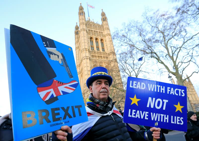 Westminster protester and anti Brexit activist Steve Bray holds his placards after a Reuters interview near the Parliament Buildings in Westminster
