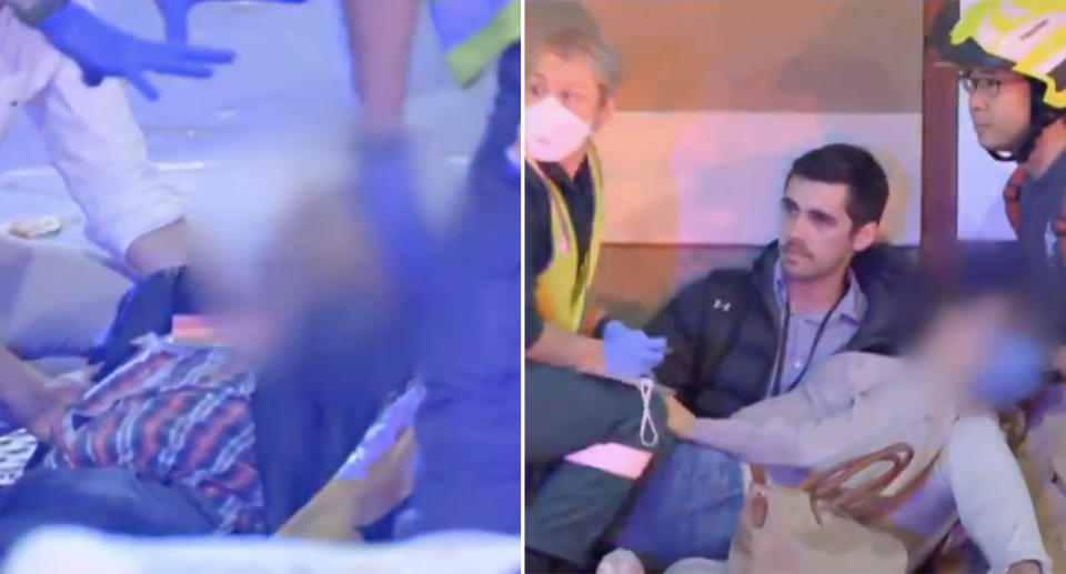 Two of the victims of the crash in Southbank, Melbourne, receive help from paramedics.