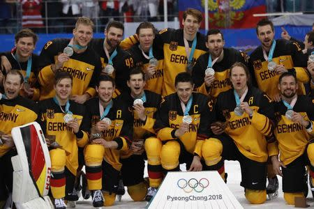 Ice Hockey - Pyeongchang 2018 Winter Olympics - Men Final Match - Olympic Athletes from Russia v Germany - Gangneung Hockey Centre, Gangneung, South Korea - February 25, 2018 - German team players pose with their silver medals. REUTERS/Grigory Dukor