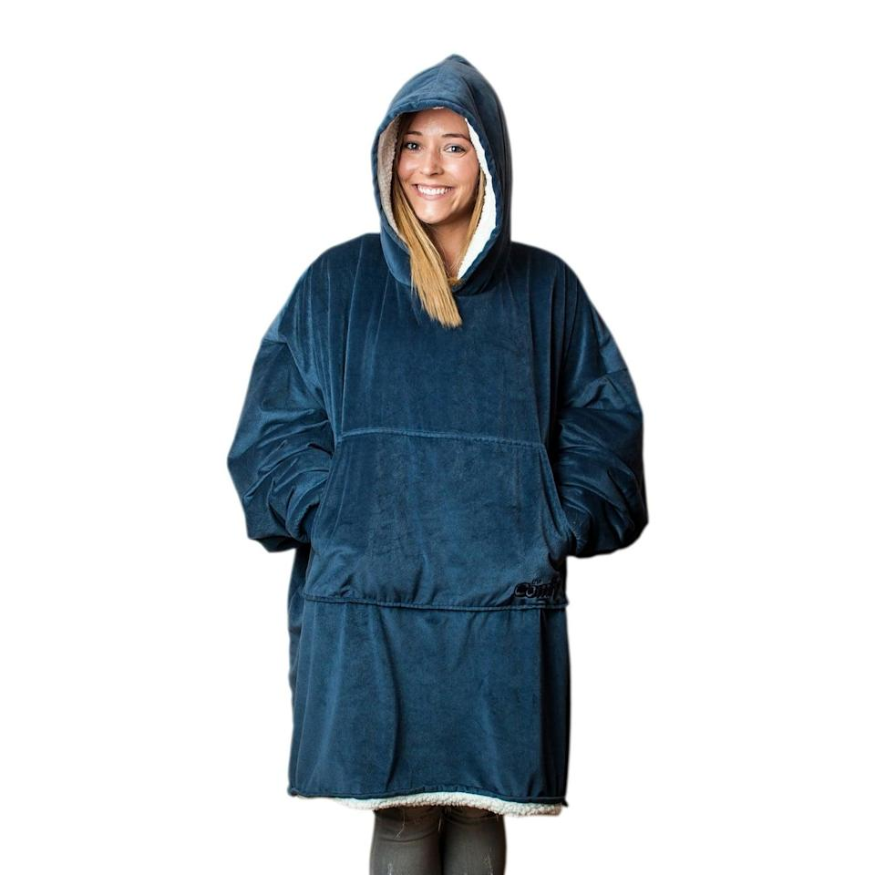 <p>If they are all about the cozy vibes and enjoying a movie night rather than going out on a Saturday night, they'll absolutely obsess over <span>The Comfy Original Wearable Blanket</span> ($45). It comes in a variety of different colors!</p>