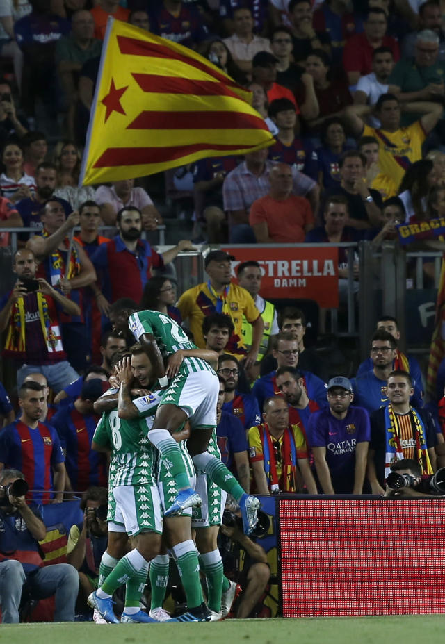 Betis' players celebrate after his teammate Betis' Nabil Fekir scores his side's first goal during the Spanish La Liga soccer match between FC Barcelona and Betis at the Camp Nou stadium in Barcelona, Spain, Sunday, Aug. 25, 2019. (AP Photo/Joan Monfort)