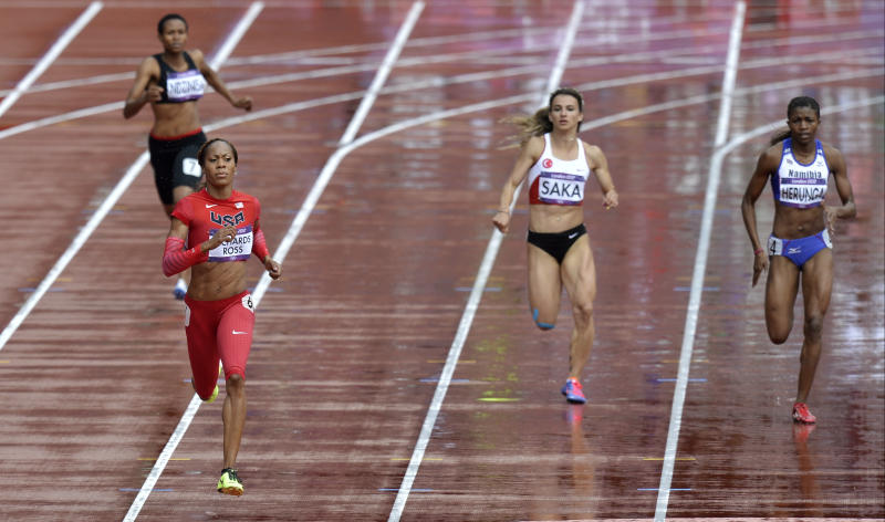 United States' Sanya Richards-Ross, front left, competes in a women's 400-meter heat during the athletics in the Olympic Stadium at the 2012 Summer Olympics, London, Friday, Aug. 3, 2012. (AP Photo/Martin Meissner)
