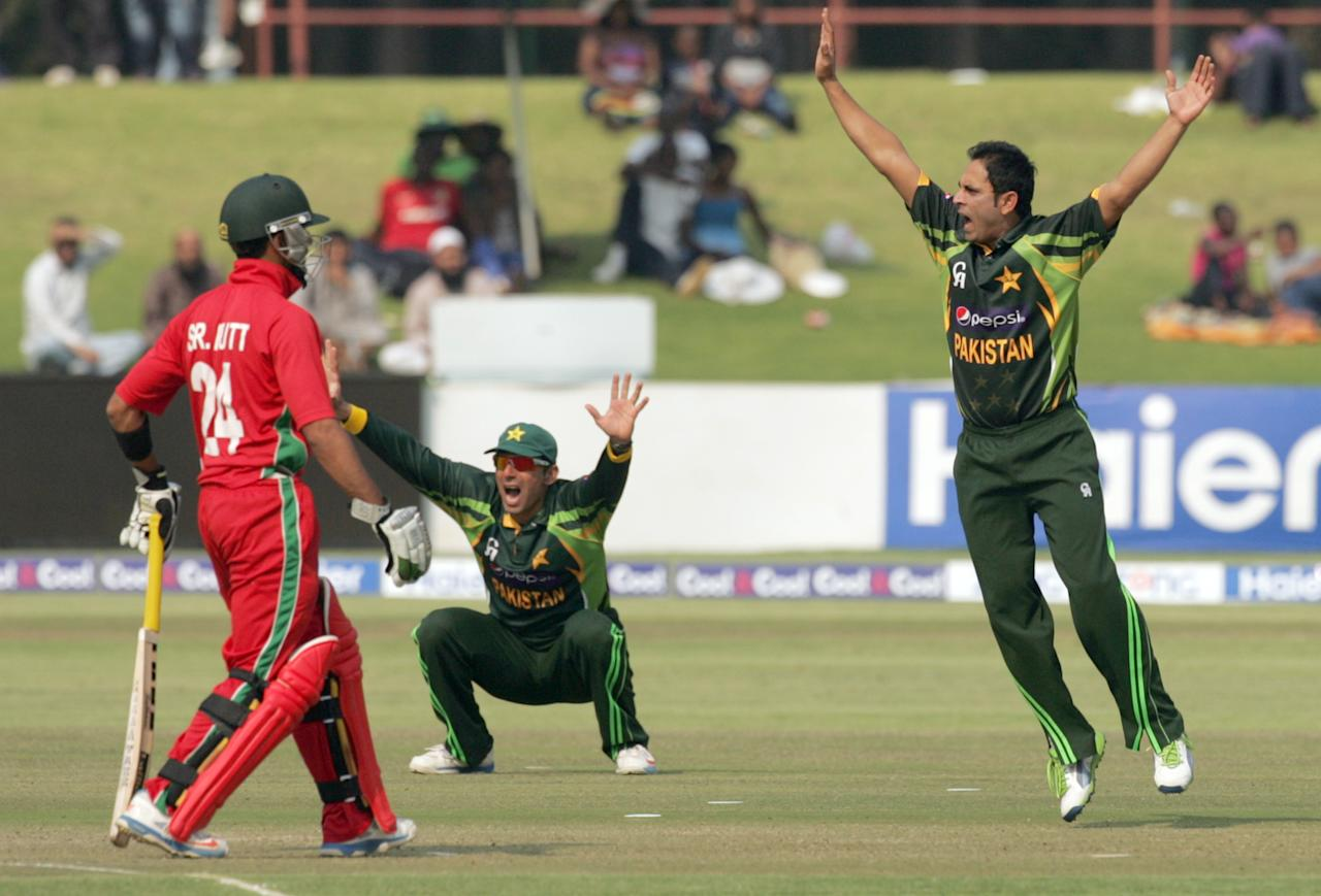 Pakistan bowler Adbul Rehman appeals for the wicket of Zimbabwe batsman Sikanda Raza Butt (L) on August 31, 2013 during the third and final one-day international at the Harare Sports Club. AFP PHOTO / JEKESAI NJIKIZANA        (Photo credit should read JEKESAI NJIKIZANA/AFP/Getty Images)