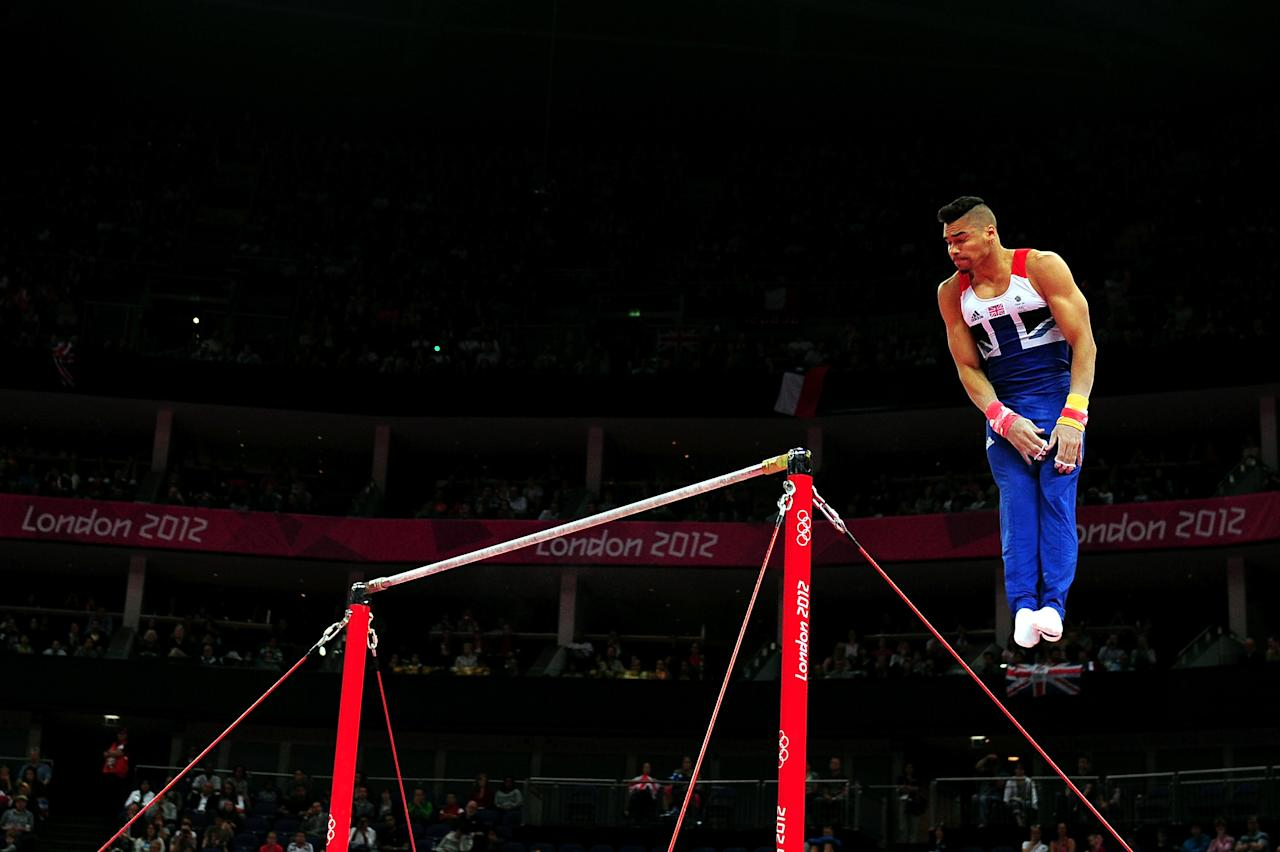 LONDON, ENGLAND - JULY 28:  Louis Smith of Great Britain competes in the horizontal bars in the Artistic Gymnastics Men's Team qualification on Day 1 of the London 2012 Olympic Games at North Greenwich Arena on July 28, 2012 in London, England.  (Photo by Mike Hewitt/Getty Images)