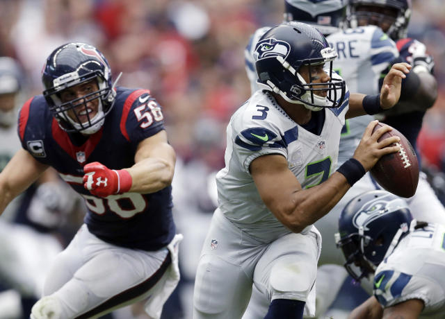 Seattle Seahawks' Russell Wilson (3) is pressured by Houston Texans' Brian Cushing (56) during the third quarter an NFL football game on Sunday, Sept. 29, 2013, in Houston. (AP Photo/David J. Phillip)