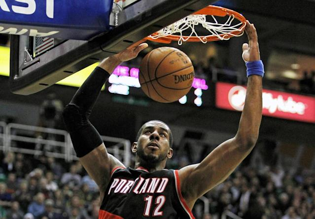 """FILE - In this Feb. 1, 2013, file photo, Portland Trail Blazers forward LaMarcus Aldridge (12) dunks the ball against the Utah Jazz in the first half during an NBA basketball game in Salt Lake City. The late-game """"M-V-P!"""" chants are now the norm in Portland for Aldridge, and the Trail Blazers' forward is putting up numbers worthy of such adulation. (AP Photo/Steve C. Wilson, File)"""
