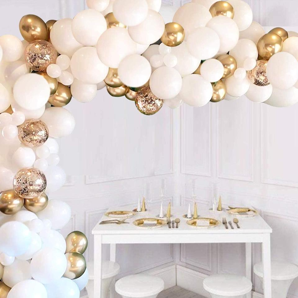 <p>You can't go wrong with this timeless and classic <span>JOYYPOP 110-Piece White and Gold Balloon Arch Kit</span> ($18).</p>