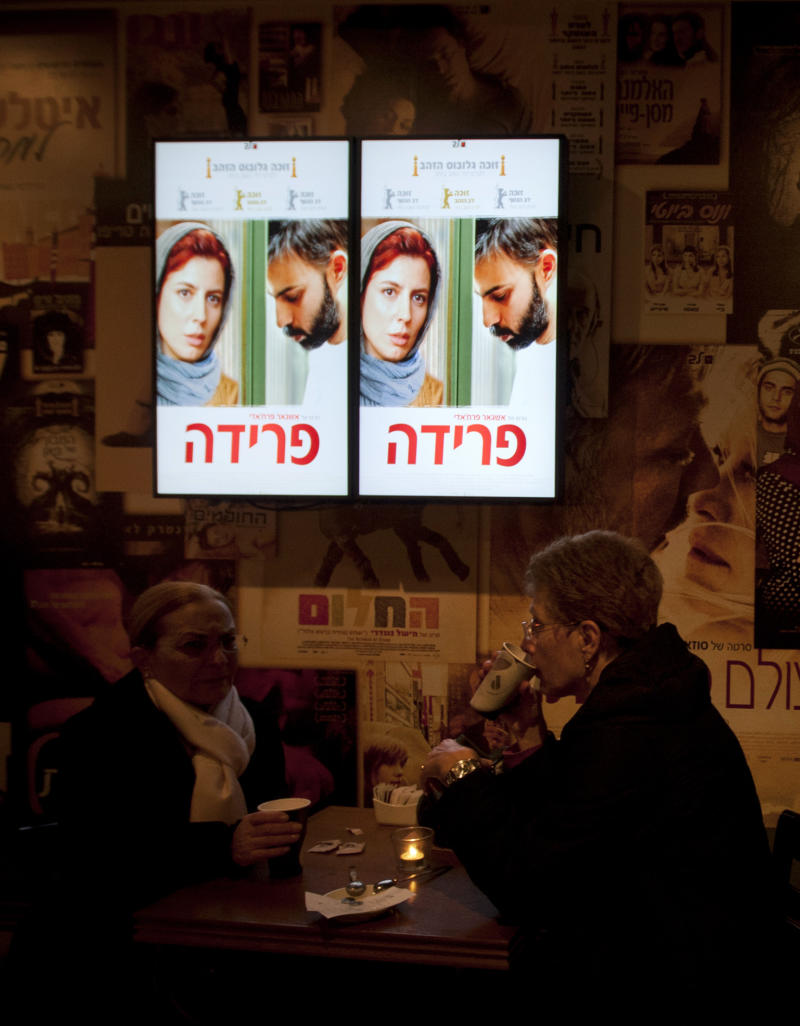 """In this Sunday, Feb. 26, 2012 photo Israelis wait for the screening of the Iranian movie """"A Separation"""" at a movie theater in Jerusalem. Israeli newspapers warn daily of the Iranian nuclear threat, but for the past week and a half, Israelis filmgoers have packed movie theaters to watch a drama set in Tehran. """"A Separation,"""" a domestic drama directed by Iranian Asghar Farhadi, bested an Israeli rival and three others on Sunday to win the award for best foreign film.(AP Photo/Sebastian Scheiner)"""