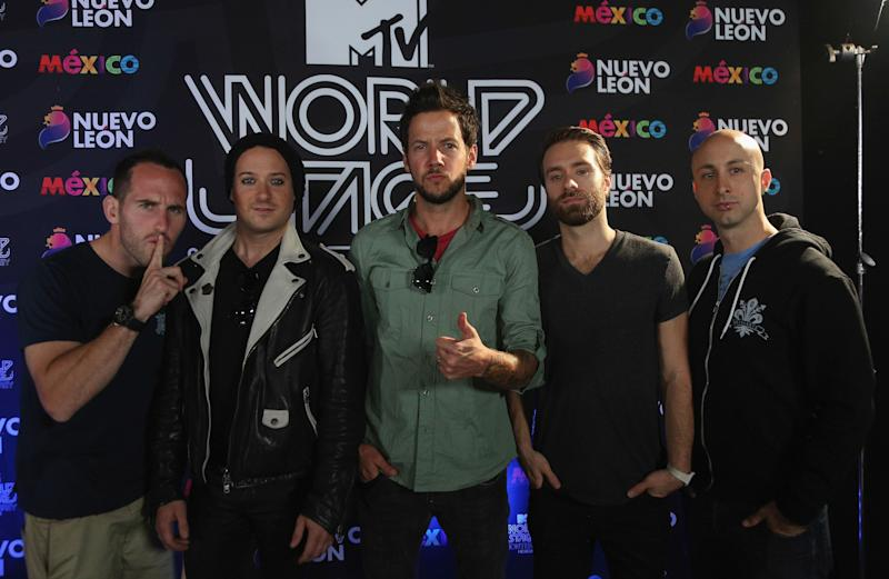 Chuck Comeau, David Desrosiers, Pierre Bouvier, Sebastien Lefebvre, and Jeff Stinco of Simple Plan attend a press conference during the MTV World Stage at Arena Monterrey on October 3, 2013 in Mexico. (Photo: Victor Chavez via Getty Images)