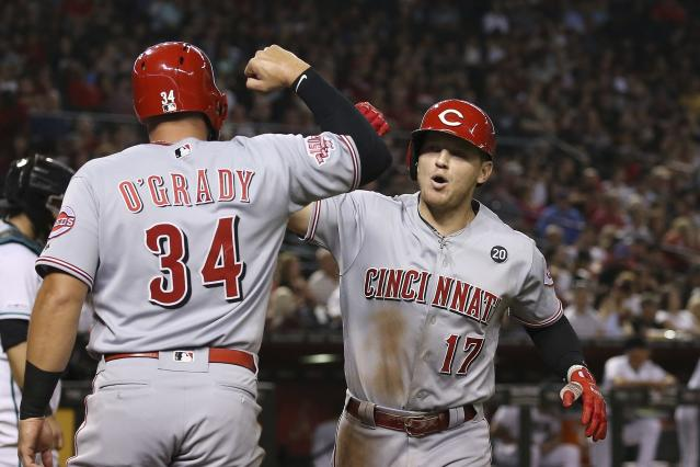 Cincinnati Reds' Josh VanMeter (17) celebrates his two-run home run against the Arizona Diamondbacks with teammate Brian O'Grady (34) during the fifth inning of a baseball game Friday, Sept. 13, 2019, in Phoenix. (AP Photo/Ross D. Franklin)