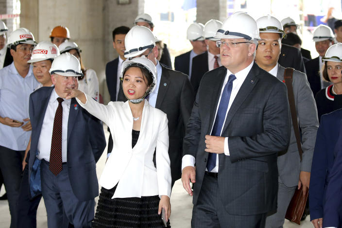 FILE - In this Aug. 23, 2019, file photo, Australian Prime Minister Scott Morrison, right, visits the Hanoi Formula One Grand Prix construction site in Hanoi. (AP Photo/Duc Thanh, File)