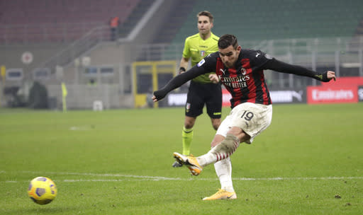 AC Milan's Ante Rebic scores his side's second goal during a Serie A soccer match between AC Milan and Parma, at the San Siro stadium in Milan, Italy, Sunday, Dec. 13, 2020. (AP Photo/Luca Bruno)