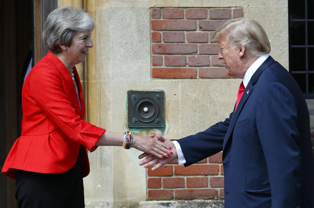 <p>President Donald Trump, right, is greeted by British Prime Minister Theresa May, left, at Chequers, in Buckinghamshire, England, Friday, July 13, 2018. (Photo: Pablo Martinez Monsivais/AP) </p>