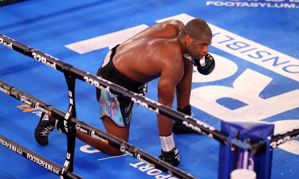 Daniel Dubois takes a knee in the 10th round of his British heavyweight title bout with Joe Joyce. He was later revealed to have a badly broken eye socket.
