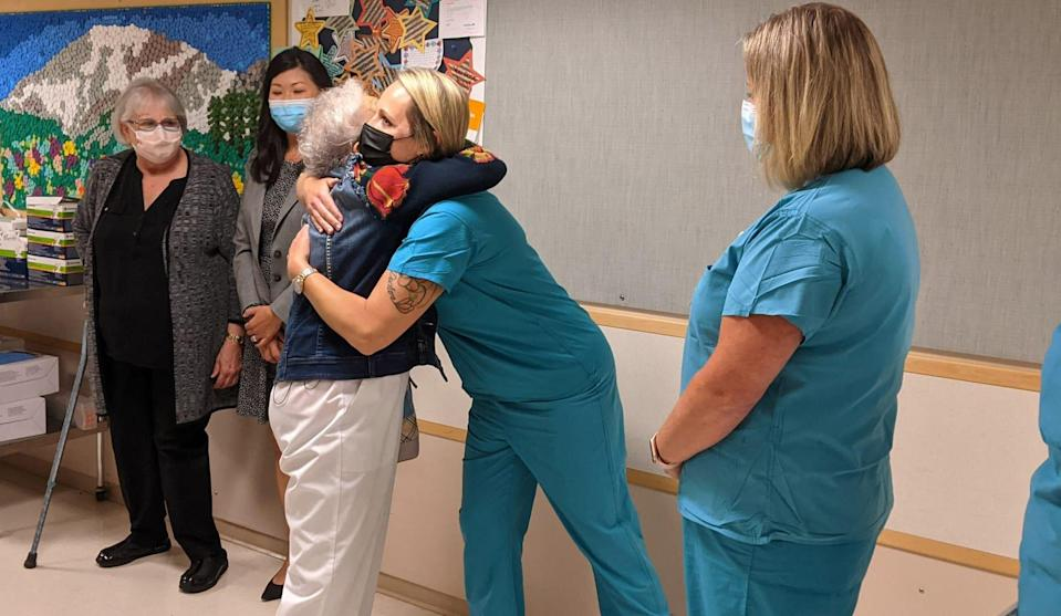 """Florence """"SeeSee"""" Rigney says good bye to staff at MultiCare Tacoma General Hospital on her last day."""