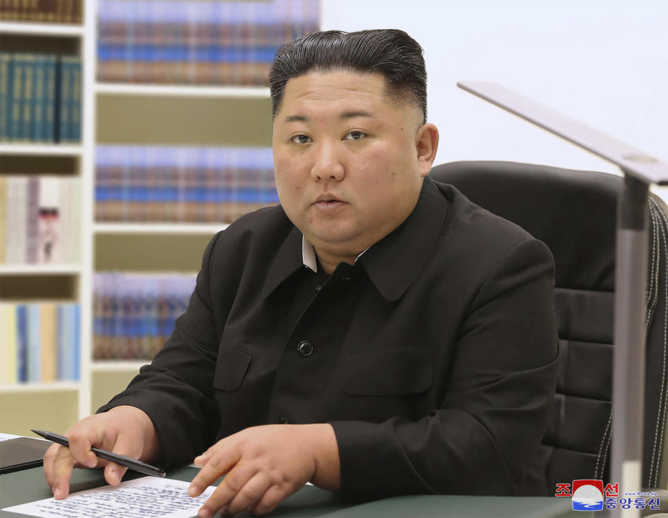"In this undated photo provided on Jan. 1, 2021, by the North Korean government, North Korean leader Kim Jong Un writes his New Year card to the public. Kim thanked the public for their trust and support ""in the difficult times"" and wished them happiness and good health in his first New Year's Day cards sent to his people.Independent journalists were not given access to cover the event depicted in this image distributed by the North Korean government. The content of this image is as provided and cannot be independently verified. Korean language watermark on image as provided by source reads: ""KCNA"" which is the abbreviation for Korean Central News Agency.(Korean Central News Agency/Korea News Service via AP)"