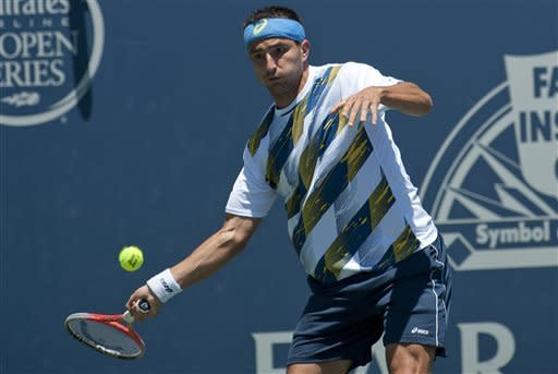 Marinko Matosevic, of Australia, returns the ball in a semifinals singles match against Ricardas Berankis, of Lithuania, at the Farmers Classic tennis tournament, Saturday, July 28, 2012, in Los Angeles. (AP Photo/Grant Hindsley)