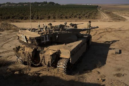 An Israeli soldier stands atop a tank near the border with Gaza July 27, 2014. REUTERS/Siegfried Modola