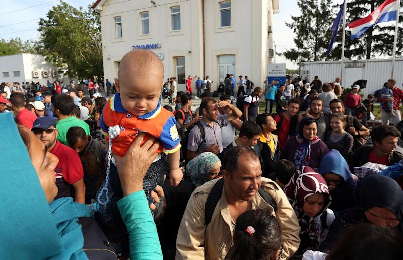 A train transporting 800 people arrived near Zagreb from the border, but thousands more were waiting for trains in baking sun at a tiny station near the Serb frontier on September 17, 2015 (AFP Photo/)