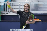 Stefanos Tsitsipas of Greece waves to the crowd after defeating Damir Dzumhur of Bosnia during the Miami Open tennis tournament, Saturday, March 27, 2021, in Miami Gardens, Fla. (AP Photo/Marta Lavandier)