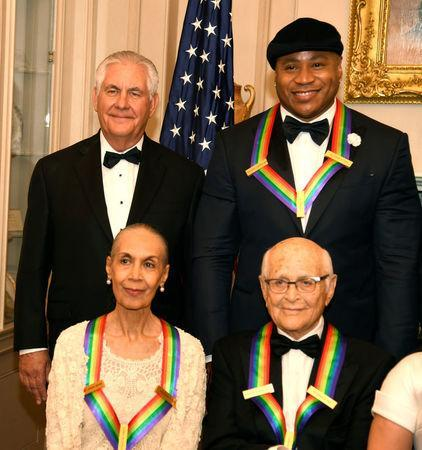 U.S. Secretary of State Rex Tillerson (L, standing) poses with 2017 Kennedy Center Honorees Rapper LL Cool J (R, standing) and (seated L-R) dancer, actress and choreographer Carmen de Lavallade and TV writer Norman Lear, for a group photo at the conclusion of a gala dinner at the U.S. State Department, in Washington, U.S., December 2, 2017. REUTERS/Mike Theiler