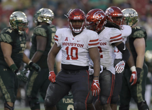 "Houston defensive tackle <a class=""link rapid-noclick-resp"" href=""/ncaaf/players/266709/"" data-ylk=""slk:Ed Oliver"">Ed Oliver</a> (10) during the first half of an NCAA college football game against South Florida Saturday, Oct. 28, 2017, in Tampa, Fla. (AP Photo/Chris O'Meara)"