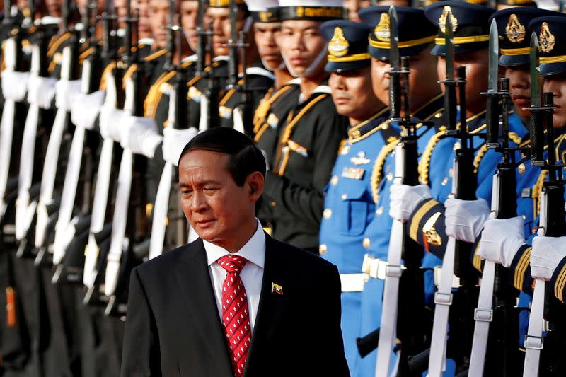FILE PHOTO: Myanmar's President Win Myint reviews the honor guard during his welcome ceremony at the Government House in Bangkok