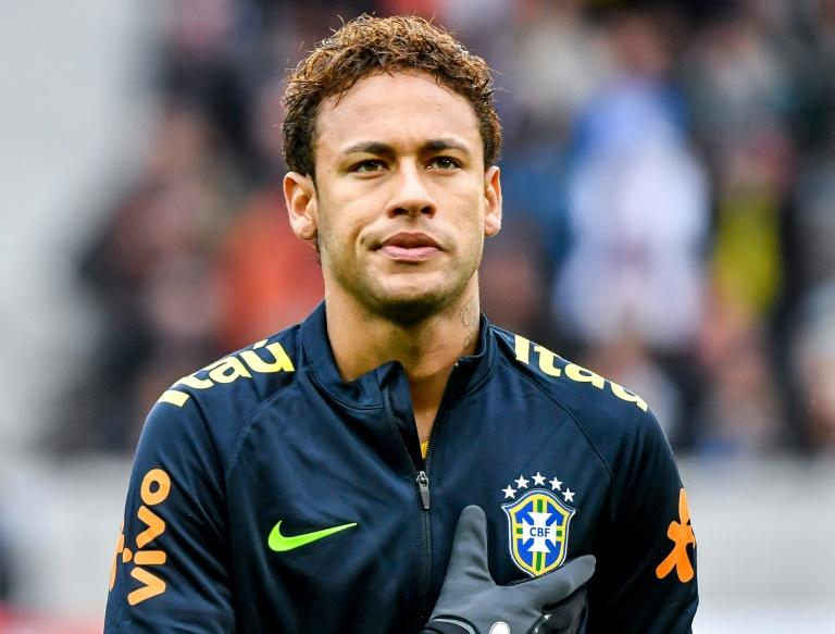 "Brazil's forward Neymar sings the national anthem ahead of a friendly football match against Japan at The ""Pierre Mauroy "" Stadium in Villeneuve d'Ascq on November 10, 2017"