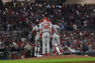 St. Louis Cardinals players converse on the mound in the eighth inning during Game 1 of a best-of-five National League Division Series against the Atlanta Braves, Thursday, Oct. 3, 2019, in Atlanta. (AP Photo/John Amis)