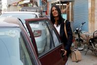 Nisha Rao, 28, a transgender woman who became country's first practicing lawyer, boards a cab, in Karachi,