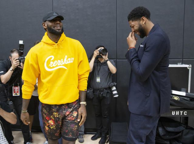 Los Angeles Lakers LeBron James, left, shares a moment with Anthony Davis (AP Photo/Damian Dovarganes)