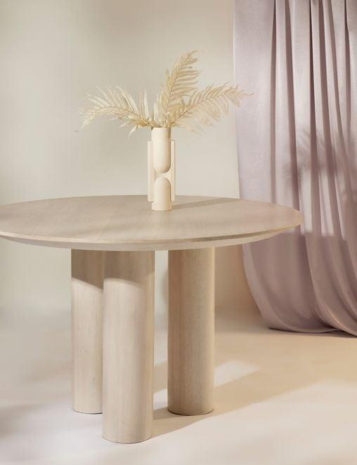 <p>We'd eat all our meals at this <span>Lulu and Georgia Mojave Round Dining Table</span> ($1,498).</p>