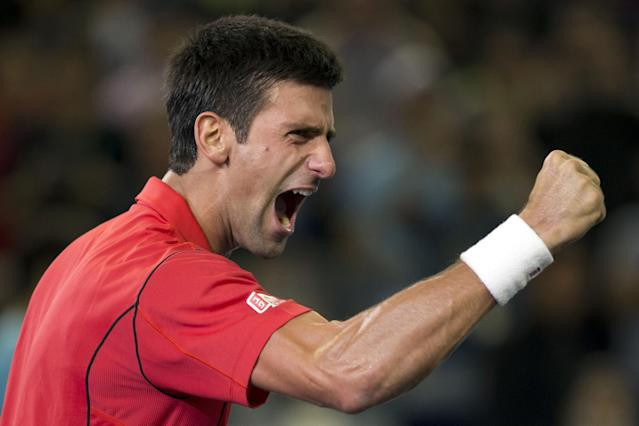 Serbia's Novak Djokovic celebrates after defeating Argentina's Juan Martin del Potro in their final match of the Shanghai Masters tennis tournament at the Qizhong Forest Sports City Tennis Center in Shanghai, China, Sunday, Oct. 13, 2013. Djokovic won 6-1, 3-6, 7-6 (3). (AP Photo/Ng Han Guan)