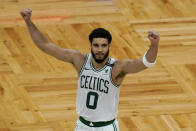 Boston Celtics forward Jayson Tatum (0) celebrates after an NBA basketball game against the San Antonio Spurs, Friday, April 30, 2021, in Boston. Tatum scored 60 points to lead the Celtics to a 143-140 victory in overtime. (AP Photo/Elise Amendola)