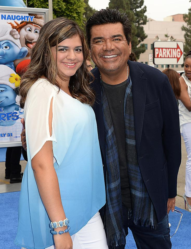 "WESTWOOD, CA - JULY 28:  Actor George Lopez (R) and Mayan Lopez attend the premiere of Columbia Pictures' ""Smurfs 2"" at Regency Village Theatre on July 28, 2013 in Westwood, California.  (Photo by Jason Merritt/Getty Images)"