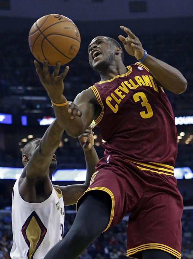 Cleveland Cavaliers shooting guard Dion Waiters, right, is fouled by New Orleans Pelicans shooting guard Anthony Morrow, left, while driving to the basket in the first half of an NBA basketball game in New Orleans, Friday, Nov. 22, 2013. (AP Photo/Gerald Herbert)