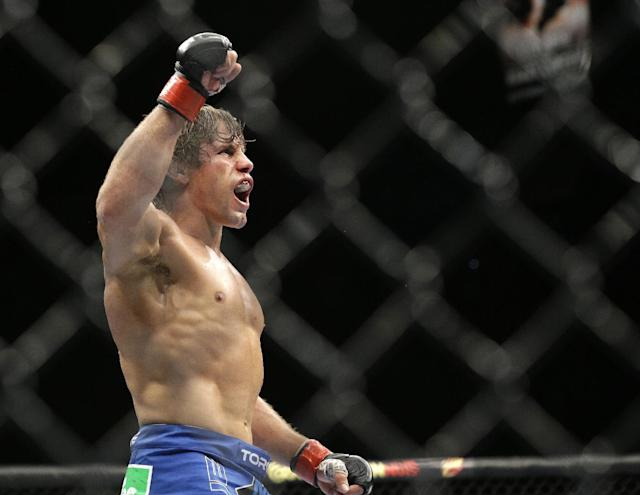 Urijah Faber celebrates after defeating Alex Caceres in their bantamweight mixed martial arts bout at UFC 175 on Saturday, July 5, 2014, in Las Vegas. (AP Photo/John Locher)