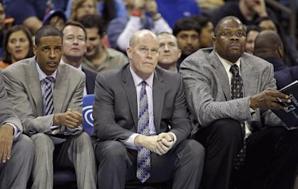 Stephen Silas, from left, on the bench with Hornets coach Steve Clifford and Patrick Ewing. (AP)