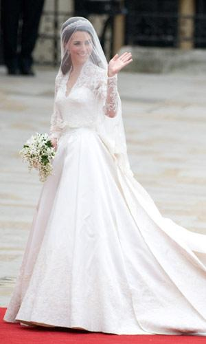 It was the dress seen by (reportedly) a billion people. Kate's Alexander McQueen by Sarah Burton wedding gown made all engaged women want copies and all single ladies to covet this stunning piece of fashion. The V-neck dress featured a long-sleeved lace overlay, 9-foot train, satin skirt and 58 buttons. Fit for a princess indeed. (Samir Hussein/WireImage.com)