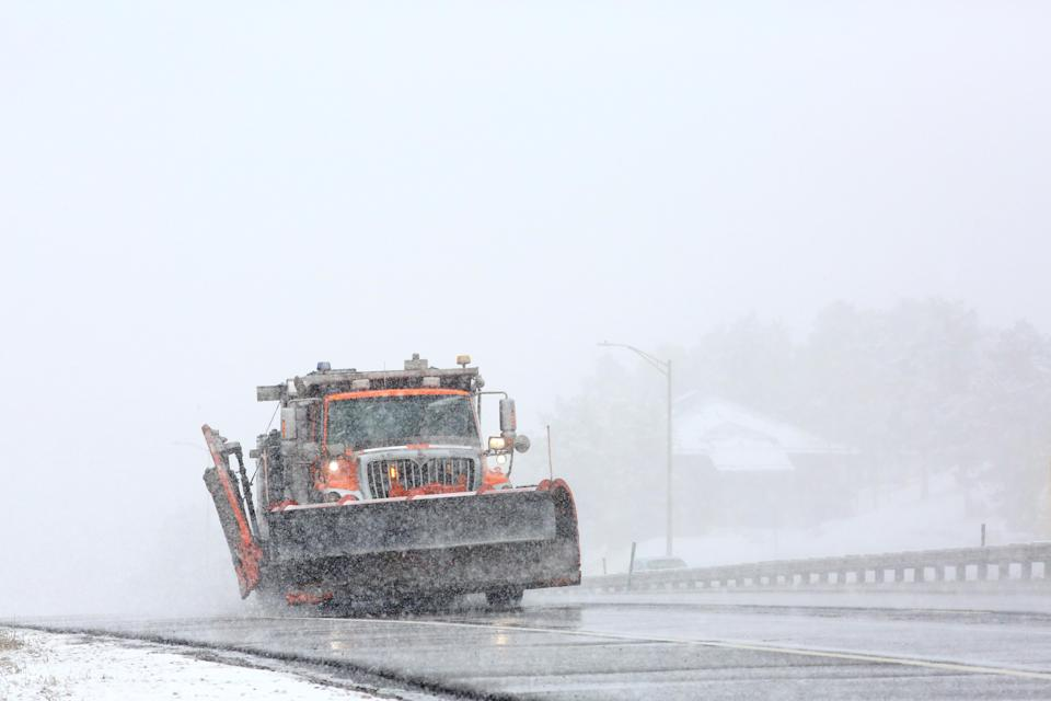 A snowplow patrols U.S. Interstate 70 in Colorado in the initial hours of a winter storm which meteorologists predict could bring several feet of snow to parts of the state, March 13, 2021. REUTERS/Kevin Mohatt