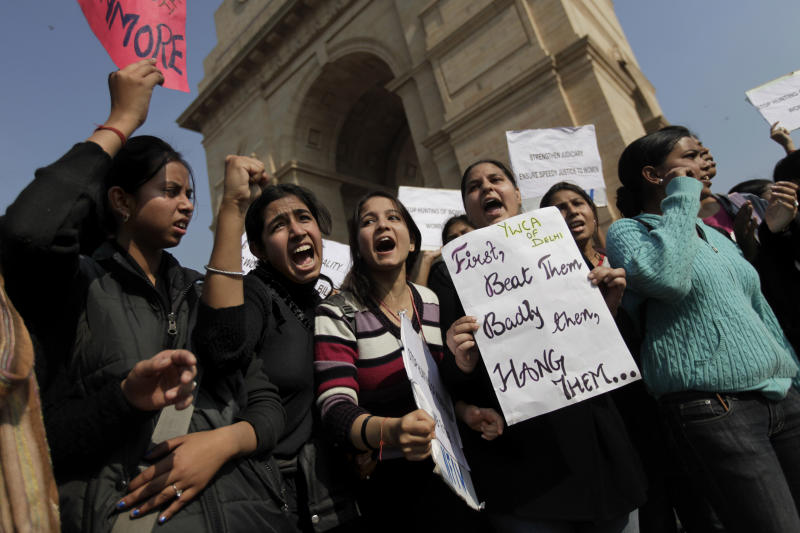Indian women shout slogans in front of India Gate during a protest in New Delhi, India, Friday, Dec. 21, 2012. The hours-long gang-rape and near-fatal beating of a 23-year-old student by six-men on a bus in New Delhi triggered outrage and anger across the country for the fifth day in a row, as Indians demanded action from authorities who have long ignored persistent violence and harassment against women. (AP Photo/Altaf Qadri)