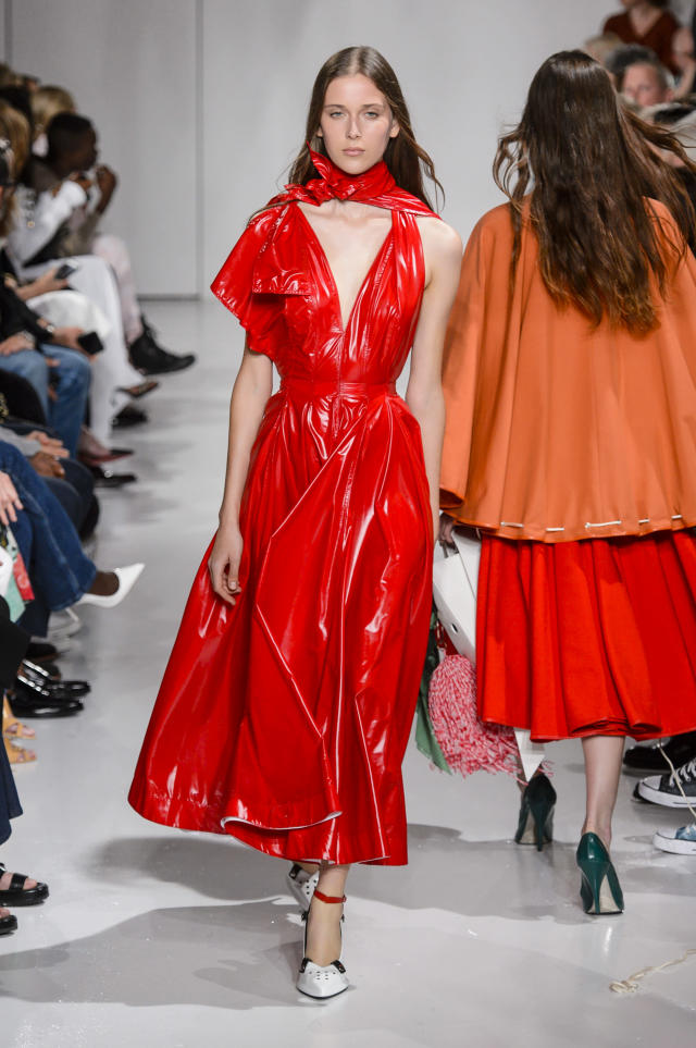 <p><i>Model wears a red patent-leather dress from the Calvin Klein SS18 collection. (Photo: IMAXtree) </i></p>