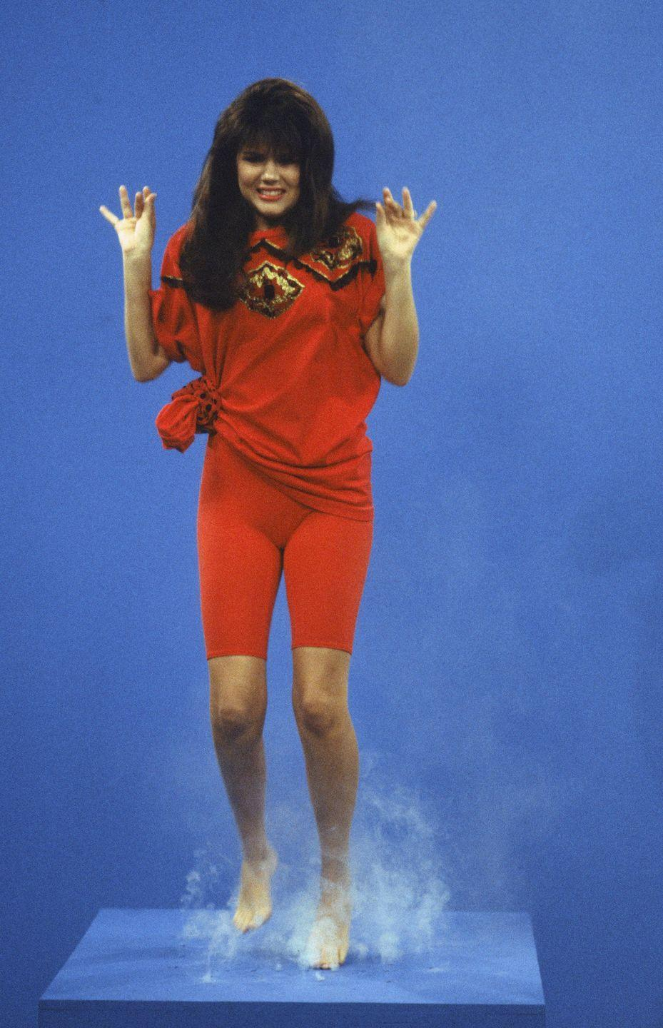 <p>Tiffani Amber Thiessen wears red bicycle shorts, while filming <em>Saved By the Bell</em>. Thiessen played the show's leading lady, Kelly Kapowski.</p>
