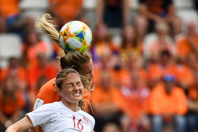 Canada's forward Janine Beckie (bottom) and Netherlands' defender Desiree van Lunteren head the ball during the France 2019 Women's World Cup Group E football match between the Netherlands and Canada, on June 20, 2019, at the Auguste-Delaune Stadium in Reims, eastern France. (Photo by Franck Fife/AFP/Getty Images)
