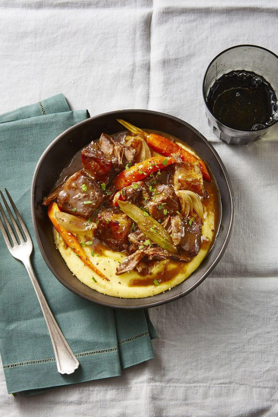 """<p>Slow-roasting short ribs is a set-it-and-forget it kind of meal; you'll have 4 hours of patiently waiting to be rewarded with a flavorful meal you'll be thinking about into next year. </p><p><em><a href=""""https://www.goodhousekeeping.com/food-recipes/a47958/red-wine-braised-short-ribs-recipe/"""" rel=""""nofollow noopener"""" target=""""_blank"""" data-ylk=""""slk:Get the recipe for Red-Wine-Braised Short Ribs »"""" class=""""link rapid-noclick-resp"""">Get the recipe for Red-Wine-Braised Short Ribs »</a></em></p>"""