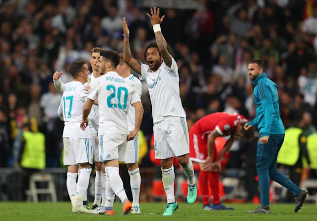 Marcelo and Real Madrid players celebrate as Bayern Munich rues another Champions League loss to its European rival. (Getty)