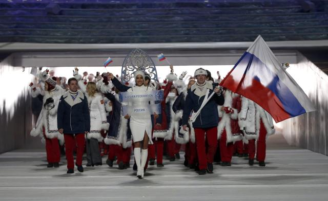 Russia's flag-bearer Alexander Zubkov leads his country's contingent during the athletes' parade at the opening ceremony of the 2014 Sochi Winter Olympics, February 7, 2014. REUTERS/Phil Noble (RUSSIA - Tags: OLYMPICS SPORT)
