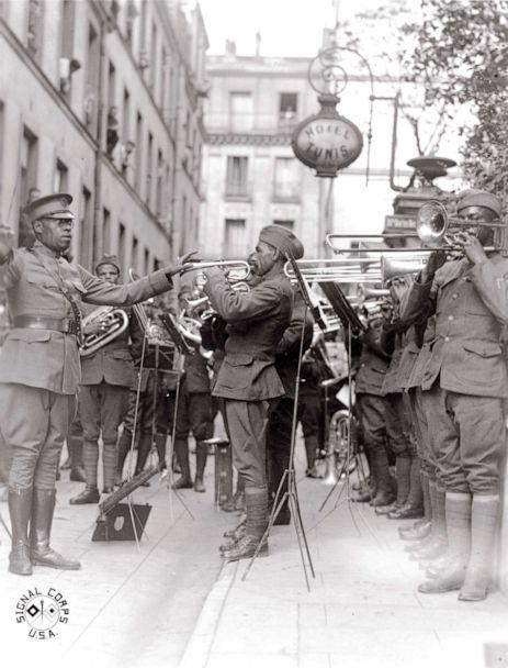 PHOTO: African American musicians members of the 369th Infantry Regiment band led by Lt. James Reese Europe, play jazz in the courtyard of a hospital for wounded Americans, in Paris, 1918. (Library of Congress)