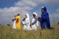 Apostolic Pentecostals celebrate Easter in field in the Johannesburg township of Soweto Sunday April 4, 2021. Similar independent churches in South Africa consist of small groups of worshippers mixing African traditions and Bible study. (AP Photo/Jerome Delay)