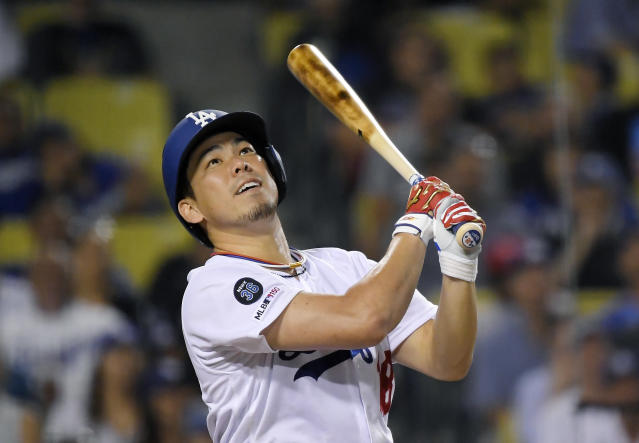 Los Angeles Dodgers' Kenta Maeda watches a foul ball during the third inning of the team's baseball game against the Toronto Blue Jays Thursday, Aug. 22, 2019, in Los Angeles. Maeda singled on the at-bat. (AP Photo/Mark J. Terrill)